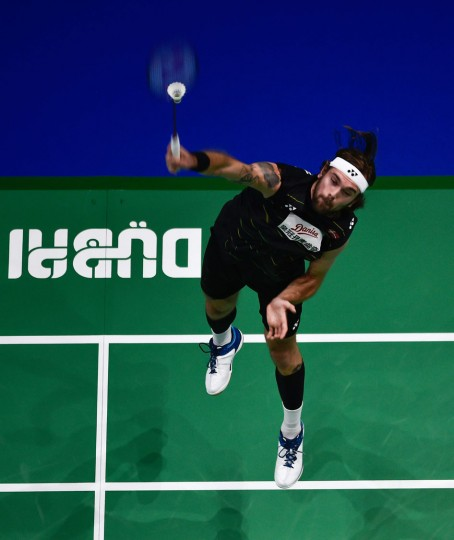 Jan Ostergaard Jorgensen of Denmark plays a shot against Hu Yun of Hong Kong during their men's singles badmindton match during the Dubai World Superseries Finals badminton tournament at the Hamdan Sports Complex in Dubai on December 14, 2016. (Stringer/AFP/Getty Images)