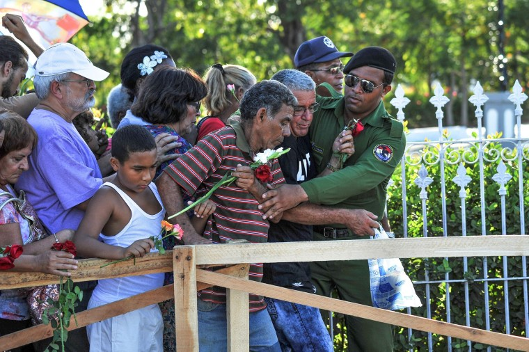 Cubans queue in line to visit Fidel Castro's tomb at the Santa Ifigenia cemetery in Santiago de Cuba on December 4, 2016. Fidel Castro's ashes were buried alongside national heroes in the cradle of his revolution, as Cuba opens a new era without the communist leader who ruled the island for decades. (Yamil Lage/AFP/Getty Images)