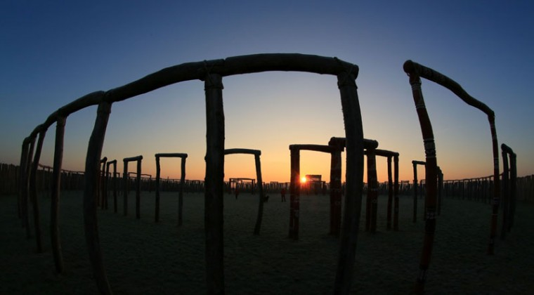"""The sun rises behind the """"Ringheiligtum Poemmelte"""" ancient ring ditch in Poemmelte-Zackmuende, south of Magdeburg, eastern Germany, on Dec. 21, 2016. The ring-shaped system, which was discovered in 1991 and reconstructed afterward, probably served as a ritual site and originally was constructed about 4,300 years ago. (PETER GERCKE/AFP/Getty Images)"""