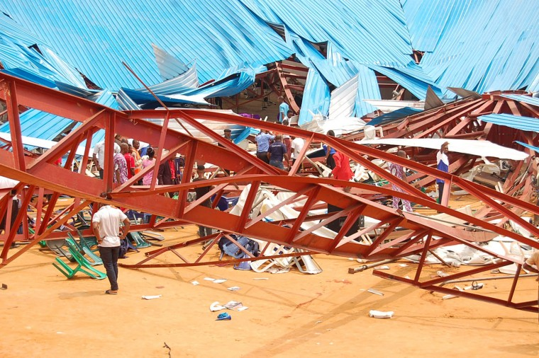 This picture taken on December 10, 2016 shows the wreckage after an evangelical church roof collapsed on worshipers in the remote southeastern city of Uyo, the capital of Akwa Ibom state. The search for survivors continued after a church roof collapsed killing at least 60 people, with many more feared dead. (Stringer/AFP/Getty Images)