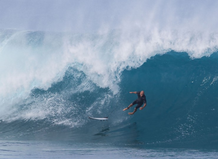 Eleven-time world surfing champion Kelly Slater of the US rides the waves on December 25, 2016 on the island of Oahu in Hawaii, following competition in Billabong Pipe Masters. Christmas Day at the pipeline was the best day of the winter season so far with huge tubes coming through great surfing rides and heavy wipeouts with the world's best surfers catching waves and dominating the pack. (Brian Bielmann/AFP/Getty Images)