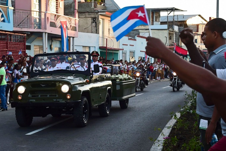 The urn with the ashes of Cuban leader Fidel Castro leaves Revolution Square in Santiago, Cuba on December 4, 2016 on its way to the cemetery. The ashes of late Cuban leader Fidel Castro were taken on Sunday to be laid to rest at a cemetery in the eastern city of Santiago de Cuba. (Ronaldo Schemidt/AFP/Getty Images)