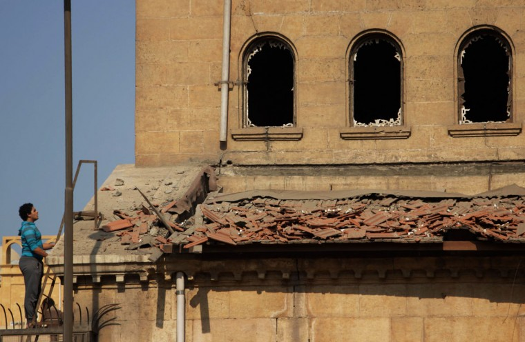 An Egyptian man looks at the damage at the scene of a bomb explosion that targeted the Saint Peter and Saint Paul Coptic Orthodox Church on December 11, 2016, in Cairo's Abbasiya neighbourhood. The blast killed at least 25 worshippers during Sunday mass inside the Cairo church near the seat of the Coptic pope who heads Egypt's Christian minority, state media said. (AFP PHOTO / SUHAIL SALEH)