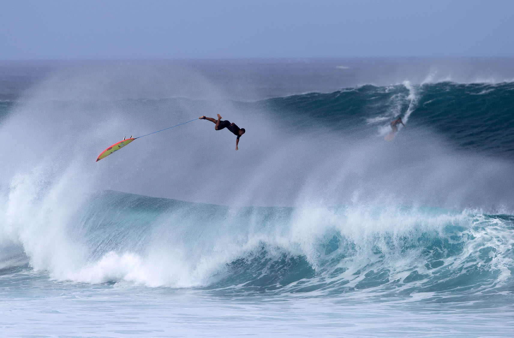 Surfers hit the waves in Hawaii on Christmas Day