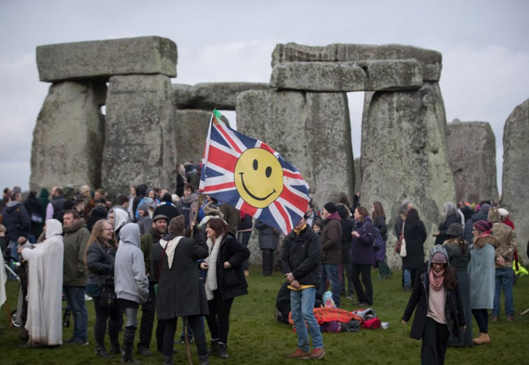 "Druids, pagans and revellers gather at Stonehenge, hoping to see the sun rise, as they take part in a winter solstice ceremony at the ancient neolithic monument of Stonehenge near Amesbury on Dec. 21, 2016 in Wiltshire, England. Despite a forecast for cloud and rain, a large crowd gathered at the famous historic stone circle, a UNESCO listed ancient monument, to celebrate the sunrise closest to the winter solstice, the shortest day of the year. The event is claimed to be more important in the pagan calendar than the summer solstice, because it marks the ""re-birth"" of the Sun for the new year. (Matt Cardy/Getty Images)"