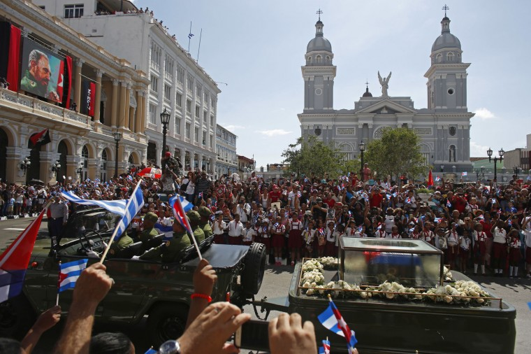 """People chant """"I am Fidel!"""" as the motorcade carrying the ashes of the late Cuban leader Fidel Castro leaves Cespedes Park in Santiago, Cuba, on Dec. 3, 2016. After days of national mourning and a tour of his ashes through the countryside, his remains have arrived at the city where they will be laid to rest. (AP Photo/Dario Lopez-Mills, File)"""