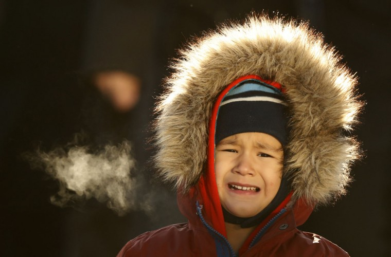 Theo Bradeen, 5, of reacts to the cold as he disembarks from a ferry after a ride from his home on Peaks Island to Portland, Maine, Friday, Dec. 16, 2016. The temperature in Portland dropped to minus-2 degrees F with a wind chill of minus-25. (AP Photo/Robert F. Bukaty)
