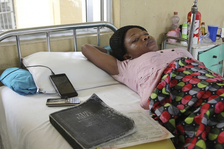 A victim of the collapsed Reigners Bible Church International building receives treatment at the university teaching hospital in Uyo, Nigeria, Monday, Dec. 12, 2016. Metal girders and the roof of a crowded church collapsed onto worshipers in southern Nigeria, killing at least 160 people with the toll likely to rise, a hospital director said Sunday.(AP Photo)