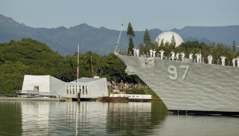 The USS Halsey passes before the USS Arizona Memorial during a moment of silence at Joint Base Pearl Harbor-Hickam, Wednesday, Dec. 7, 2016, in Honolulu. (Eugene Tanner/AP)