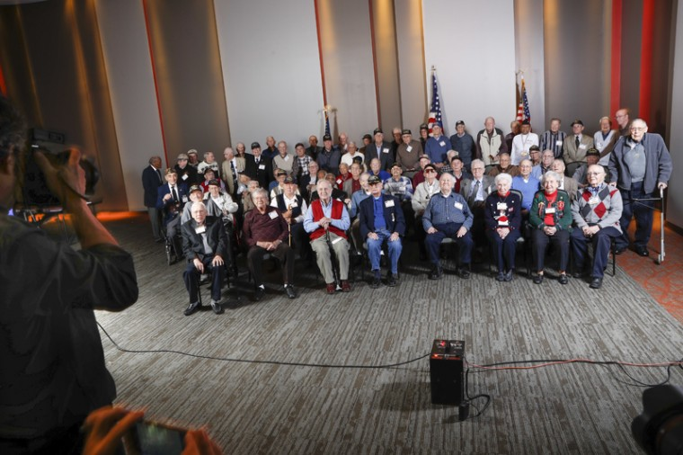 World War II veterans gather for a group photo during a ceremony at the Sharonville Convention Center to commemorate the 75th anniversary of the Dec. 7, 1941 attack on Pearl Harbor, Wednesday. Dozens of veterans gathered in in Cincinnati to share a meal and be honored for their service. (John Minchillo/AP)