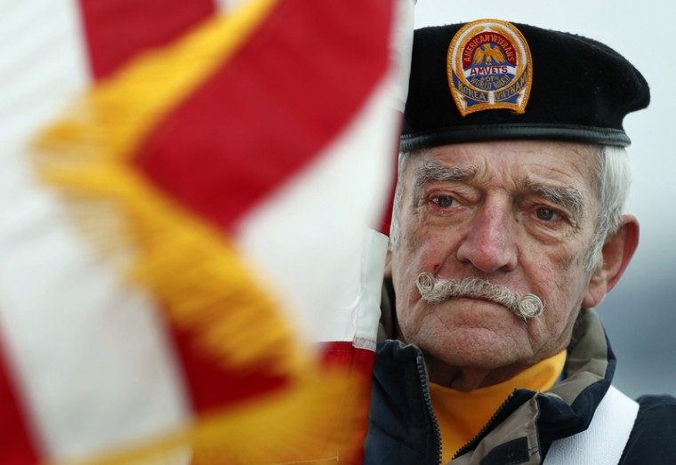 Bill Kiley, a flag bearer of the color guard, participates in a Dec. 7, 2016, ceremony in Portland, Maine, honoring those who died in the 1941 attacks on Pearl Harbor. Kiley served in the Navy from 1954-1958, at the end of the Korean War. (Robert F. Bukaty/AP)