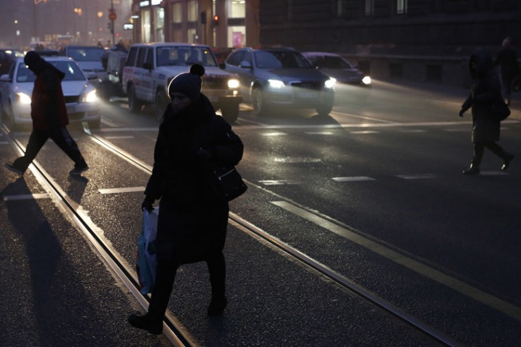 People walk on a street during rush hour in Sarajevo, Bosnia, on Wednesday, Dec. 21, 2016. Cold weather without snow marked the first day of winter in Balkan region. (Amel Emric/AP)