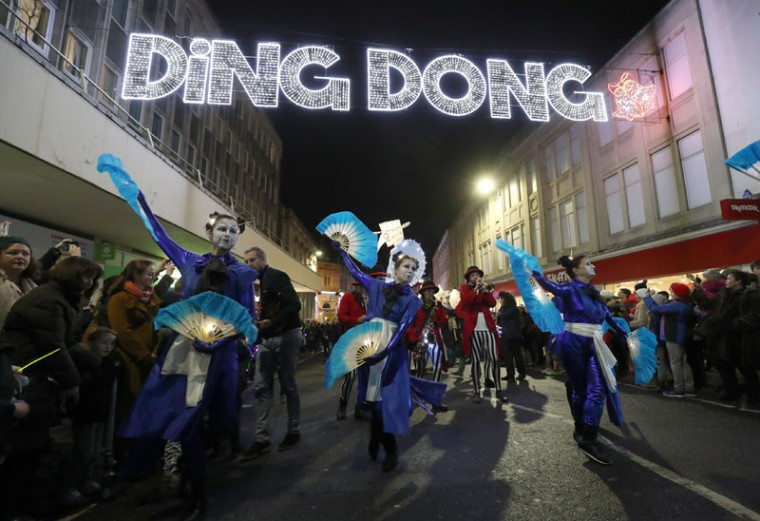 Performers dance in the street as the Burning the Clocks parade of lanterns moves through Brighton, England, on the southeastern coast, as part of celebrations of the Winter Solstice, Wednesday Dec. 21, 2016. Every year people make paper and willow lanterns to carry through their city which are then burnt on the beach. (Andrew Matthews/PA via AP)