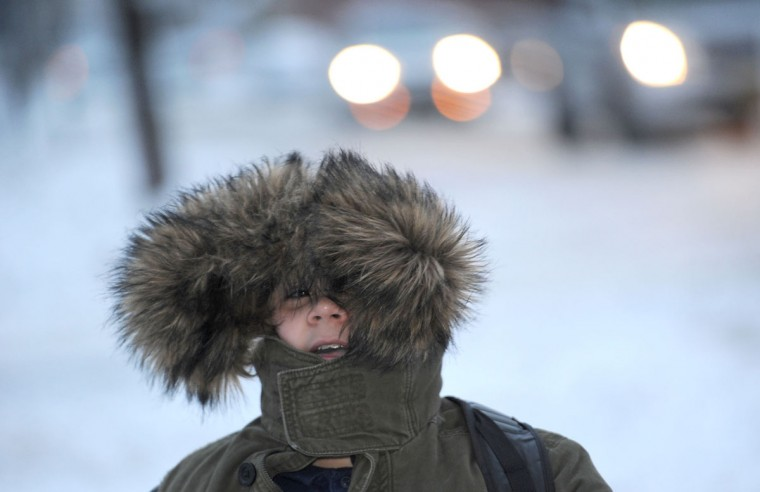 asim Kantarevic, 12, keeps his hood up as he walks to school on Thursday, Dec. 15, 2016 in Erie, Pa. Much of the northern Mid-Atlantic and Northeast will stay cold for the next couple of days as the arctic air remains stuck over the northern Appalachians, the National Weather Service said. (Christopher Millette/Erie Times-News via AP)