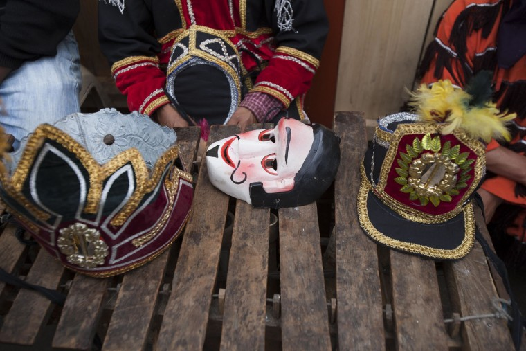"A costume mask and hats sit on a marimba instrument during a break at celebrations honoring Saint Thomas, the patron saint of Chichicastenango, Guatemala, Wednesday, Dec. 21, 2016. ""We dance for the patron, it's a tradition in my family,"" said Jose Tecun, as he rested after eight hours of dancing with a wooden mask and sequined suit. (AP Photo/Moises Castillo)"