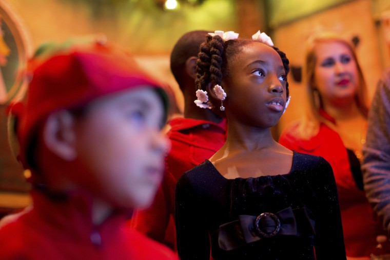 "In this Sunday, Nov. 20, 2016, photo, Amari Mack, 8, watches a video inside the ""Adventure to Santa,"" a DreamWorks DreamPlace experience at North Point Mall, in Alpharetta, Ga. The Santa experience has gotten a makeover as many malls install shows and games they hope will lure shoppers who are buying more online. (AP Photo/Branden Camp)"