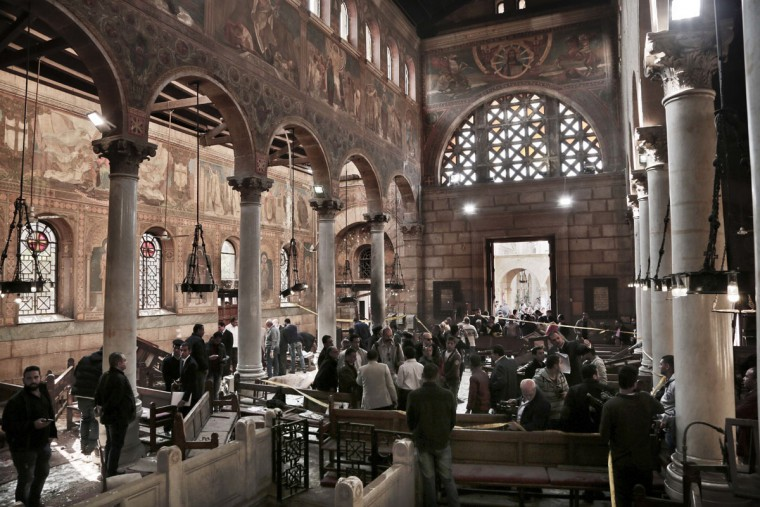 Security forces examine the scene inside the St. Mark Cathedral in central Cairo, following a bombing, Sunday, Dec. 11, 2016. The blast at Egypt's main Coptic Christian cathedral killed dozens of people and wounded many others on Sunday, according to Egyptian state television, making it one of the deadliest attacks carried out against the religious minority in recent memory. (AP Photo/Nariman El-Mofty)