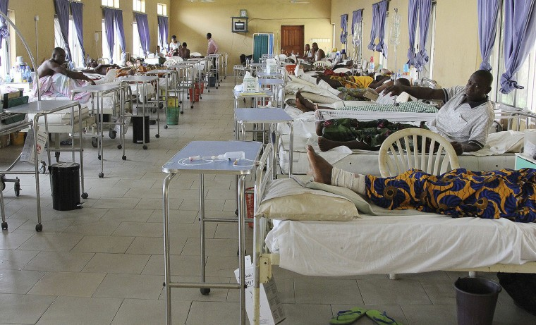 Victims of the collapsed Reigners Bible Church International building receive treatment at the university teaching hospital in Uyo, Nigeria, Monday, Dec. 12, 2016. Metal girders and the roof of a crowded church collapsed onto worshipers in southern Nigeria, killing at least 160 people with the toll likely to rise, a hospital director said Sunday. (AP Photo)