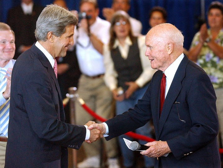In a Monday, July 26, 2004 file photo, former astronaut and Senator John Glenn welcomes Democratic presidential candidate John Kerry, left to Kennedy Space Center Visitor Center, near Cape Canaveral, Fla. Former astronaut and U.S. Sen. John Glenn Thursday, Dec. 8, 2016, died in Ohio. He was 95. (Joe Burbank/Orlando Sentinel via AP, File)