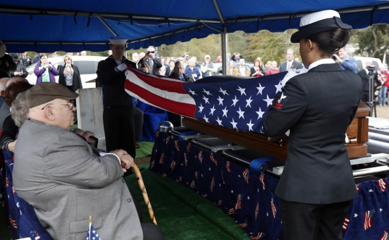 A Navy honor guard folds the American flag covering the casket of Navy Fireman First Class Jim H. Johnston, during graveside services at Wesson City Cemetery in Wesson, Miss., Wednesday, Dec. 7, 2016. Johnston was one of 429 casualties aboard the USS Oklahoma that capsized quickly after sustaining damage from several torpedoes during the Dec. 7, 1941 attack at Pearl Harbor. Most of the dead were never identified. (Rogelio V. Solis/AP)