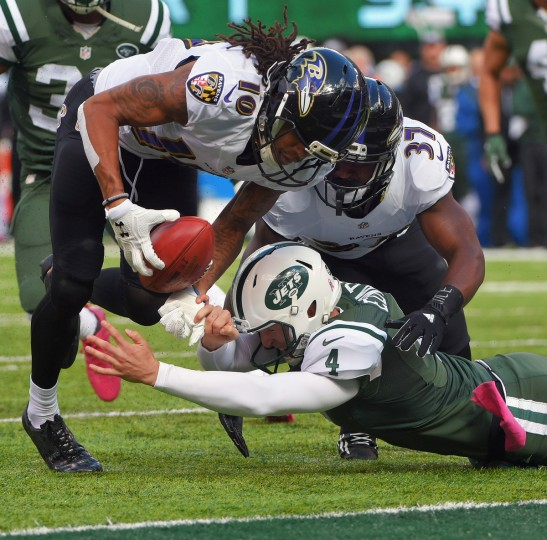 East Rutherford, NJ -- 10/23/2016 -- Baltimore Ravens' Javorius Allen (37) blocks New York Jets punter Lac Edwards (4) as Chris Moore (10) follows the muffed punt into the end zone for a touchdown during the first quarter.  (Karl Merton Ferron / Baltimore Sun)