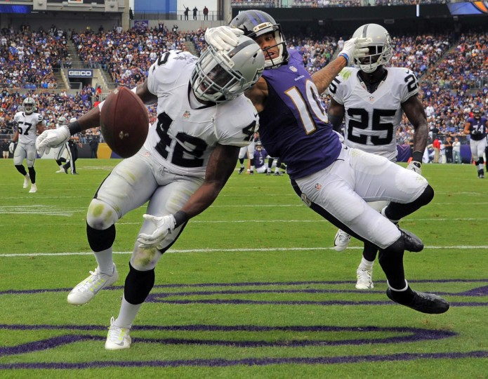 Baltimore, MD -- 10/02/2016 -- Oakland Raiders cornerback D.J. Hayden (25) watches safety Karl Joseph (42) get stopped by Baltimore Ravens wide receiver Chris Moore (10) after a pass from quarterback Joe Flacco was almost intercepted during the second quarter in Baltimore. (Karl Merton Ferron / Baltimore Sun)