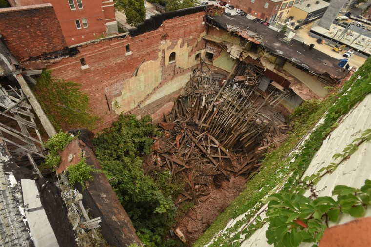 The former Mayfair auditorium was filled with structural debris from the fallen balconies. The interior, destroyed by exposure to the elements after the roof collapsed in 1998, is an example of what preservationists call demolition by neglect. This was the view in September when the partial demolition of the Mayfair theater began.  (Amy Davis/Baltimore Sun)