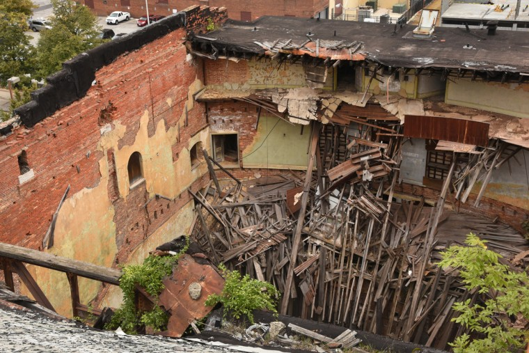 View looking down at the ruined Mayfair auditorium in September from the Congress Hotel Apartments, at the start of the partial demolition of the Mayfair theater on N. Howard Street.   (Amy Davis/Baltimore Sun)