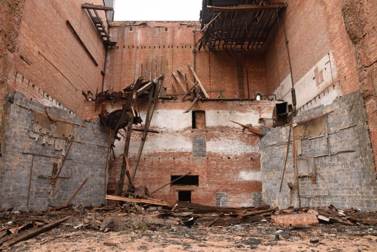 The rear of the Mayfair after the stage and supports for the fly loft were removed. The partial demolition of the Mayfair theater on N. Howard Street is nearing completion.   (Amy Davis/Baltimore Sun)