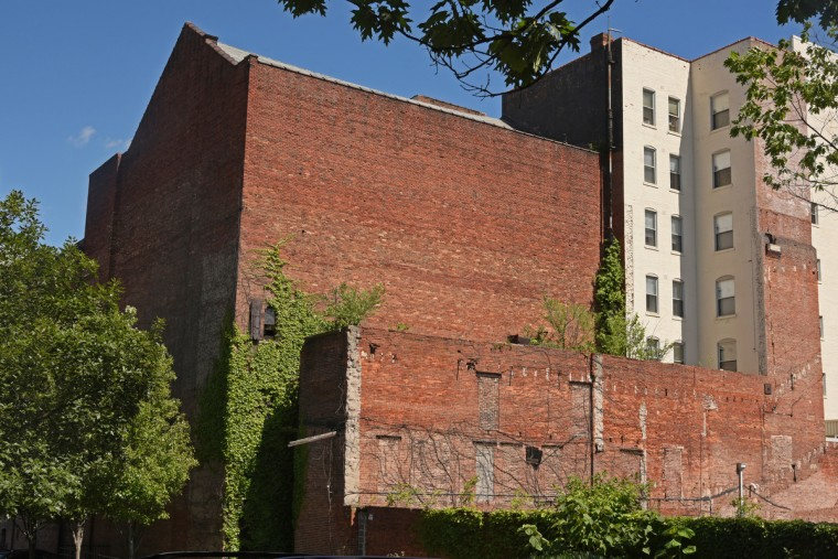 The rear of the Mayfair, facing N. Eutaw Street, and the north wall, at left, have been torn down. The partial demolition of the Mayfair theater on N. Howard Street is nearing completion.   (Amy Davis/Baltimore Sun)