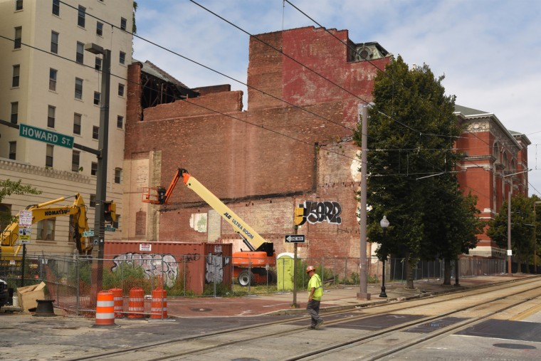 """View of the Mayfair at the start of the demolition of the south wall. The original name of the the theater, the """"Auditorium,"""" is faintly visible on the upper right corner. The partial demolition of the Mayfair theater on N. Howard Street is nearing completion.   (Amy Davis/Baltimore Sun)"""