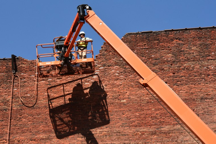 K&K Adams, Inc. construction workers carefully demolish the top of the south wall of the Mayfair by chiseling the bricks out. The partial demolition of the Mayfair theater on N. Howard Street is nearing completion.   (Amy Davis/Baltimore Sun)