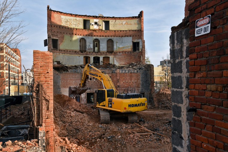 By late November, only the front of the house and a portion of the north wall remained at the Mayfair site. The partial demolition of the Mayfair theater on N. Howard Street is nearing completion. (Amy Davis/Baltimore Sun)