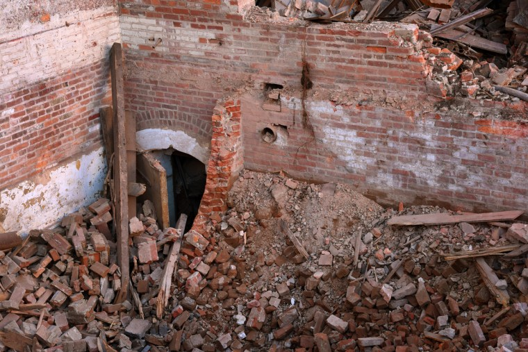 An entrance behind the demolished stage area is buried in rubble from the bricks that formed the walls.  The partial demolition of the Mayfair theater on N. Howard Street is nearing completion.   (Amy Davis/Baltimore Sun)