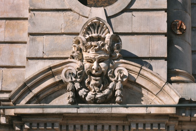 This is one of two faces that adorn the granite and terra cotta facade of the Mayfair theater, which was called the Auditorium when it opened in 1904. The facade has been saved from the partial demolition of the theater on N. Howard Street, now nearing completion. (Amy Davis/Baltimore Sun)