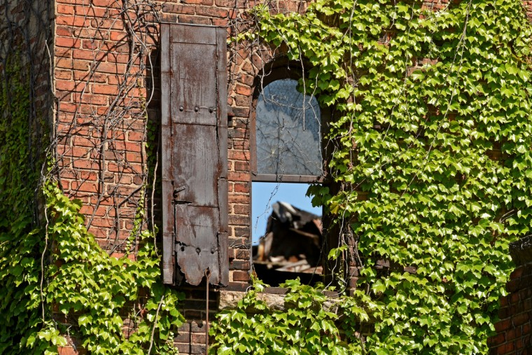 One of the windows behind the stage on the west wall of the Mayfair, which has since been torn down. The partial demolition of the Mayfair theater on N. Howard Street is nearing completion.   (Amy Davis/Baltimore Sun)