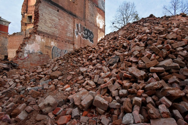 The bricks that formed the thick walls of the Mayfair are piled up before being removed from the site. The partial demolition of the Mayfair theater on N. Howard Street is nearing completion.   (Amy Davis/Baltimore Sun)
