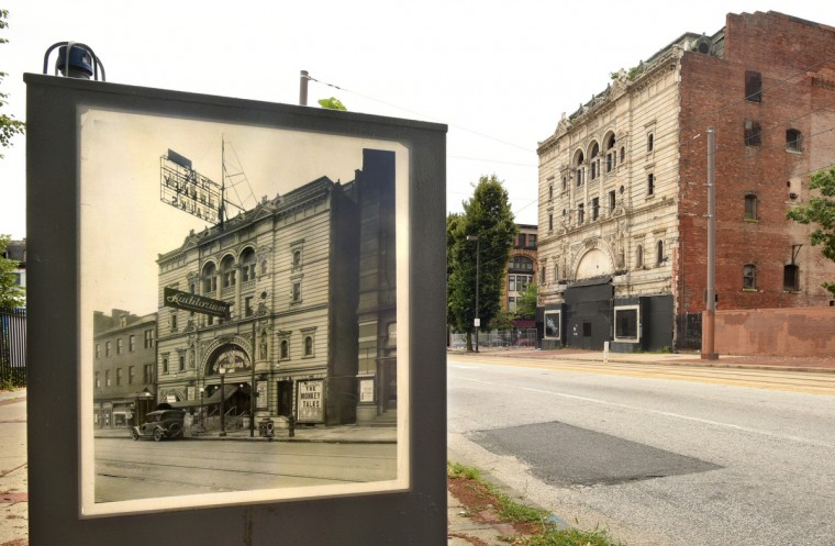 A c. 1927 Maryland Historical Society photo of the Mayfair, when it was called the Auditorium, has been posted with other historical background across N. Howard Street from the theater. The historical art installation is by Baltimore photographer James Singewald. This view, from July 2016, shows the north wall at right, which has been partially demolished. (Amy Davis/Baltimore Sun)
