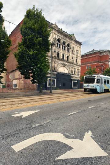 Looking north at the 500 block of North Howard Street in July 2016 toward the Mayfair as a southbound light rail train passes by. The partial demolition of the Mayfair theater on N. Howard Street is nearing completion.   (Amy Davis/Baltimore Sun)