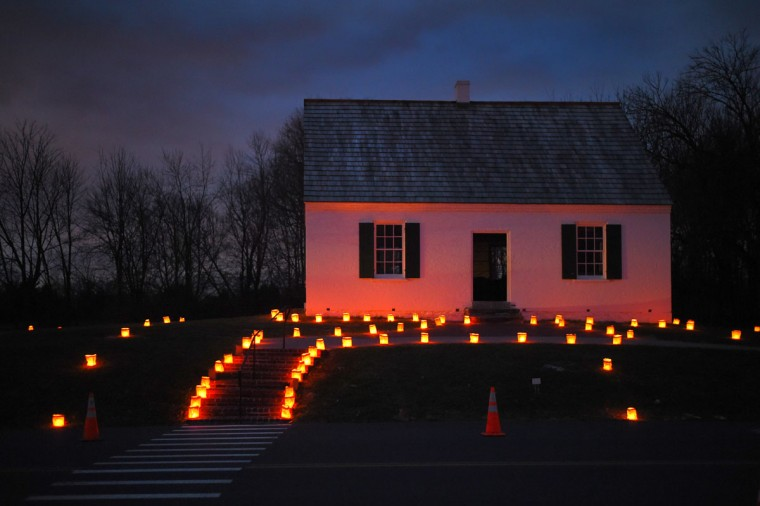 Luminaries create a fire-red glow on the Dunker Church during the 28th Annual Memorial Illumination of over 23,000 luminaries at Antietam National Battlefield. (Karl Merton Ferron/Baltimore Sun)