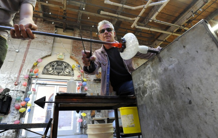 Anthony Corradetti works on a glass bowl in his studio.  (Lloyd Fox/Baltimore Sun)