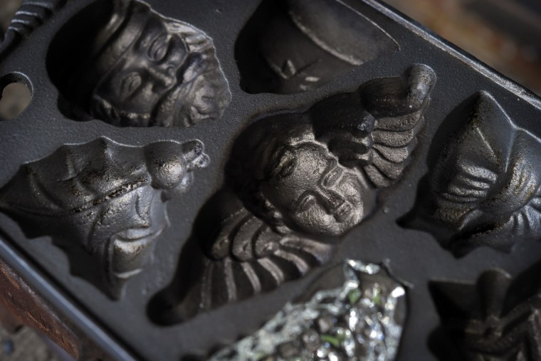 A cast iron cooking tray was used as a mold for some of the holiday ornaments made in the studio. (Lloyd Fox/Baltimore Sun)