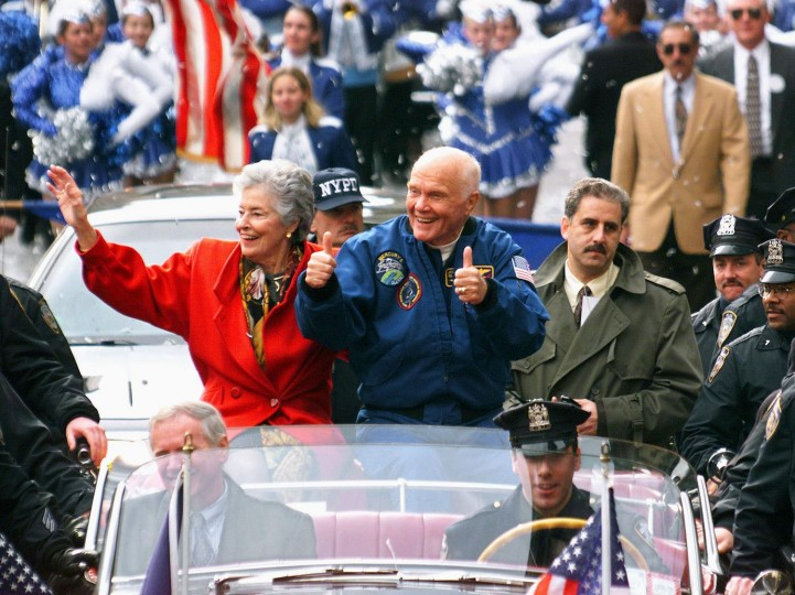 "NEW YORK, UNITED STATES: US Senator and astronaut John Glenn (R) and his wife Annie, along with the crew of the recently completed Space Shuttle Discovery mission, parade up Broadway's ""Canyon of Heroes"" 16 November as the crew were given a ticker tape parade. This is the second time the 77-year-old Glenn has received a ticker tape parade in New York with the first on 01 March, 1962 after he became the first American to ever orbit the Earth. (Timothy A. Clary/AFP/Getty Images)"