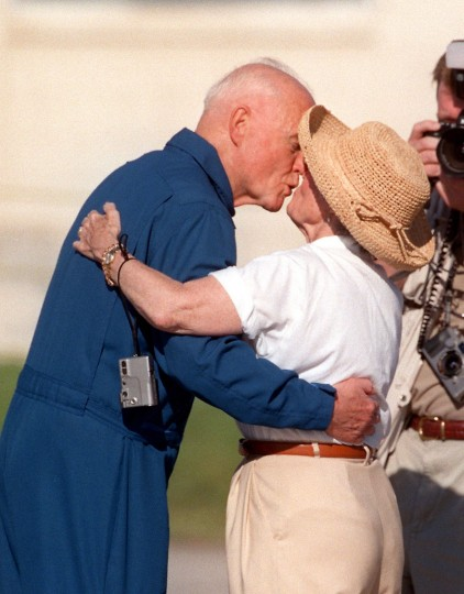 John Glenn greets his wife Annie with a kiss after arriving at Kennedy Space Center on Monday, Oct. 26, 1998. Glenn's children and grandson also welcomed him. The 77-year old senator returned to space on Oct. 29, 1998 aboard Discovery. (Red Huber/Orlando Sentinel/TNS)