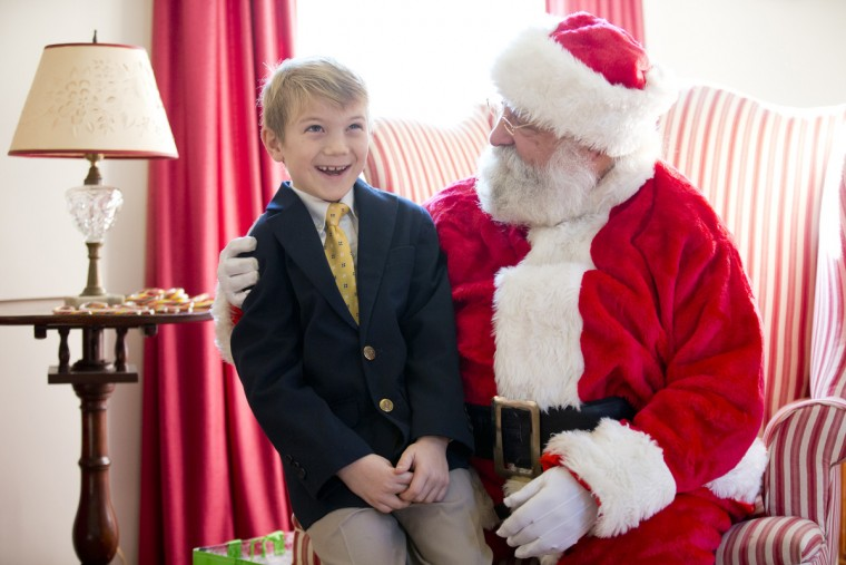 Joey Gardenghi, 7, of Catonsville talks to John Donnelly of Lakeland, dressed as Santa Claus, during the German Christmas Market at Catonsville Historical Society in Catonsville, MD in 2015. (Jen Rynda/Baltimore Sun Media Group)