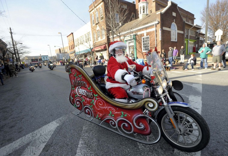 Kevin Goodman, of Carney, rides his Harley-Davidson motorcycle sleigh as Santa in the 42nd Annual Mayor's Christmas Parade, in Hampden in 2015. (Steve Ruark/Baltimore Sun Media Group)
