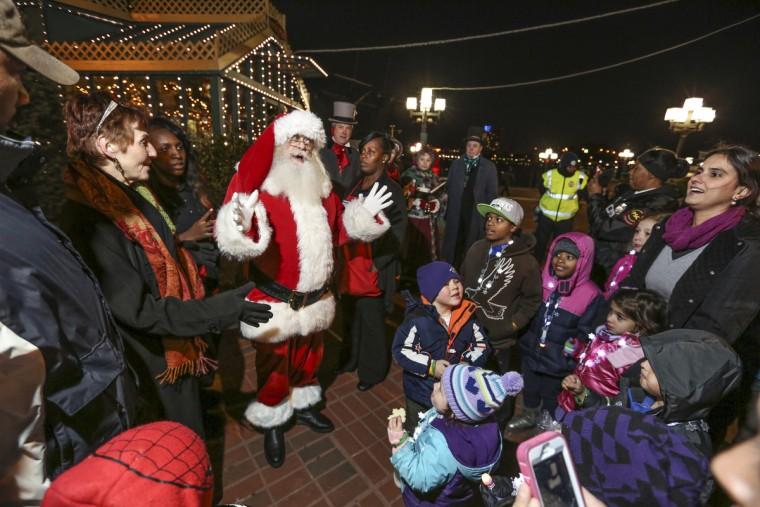 Santa Claus makes an appearance at the newly opened rink at McKeldin Square in 2014. (Kaitlin Newman/Baltimore Sun)