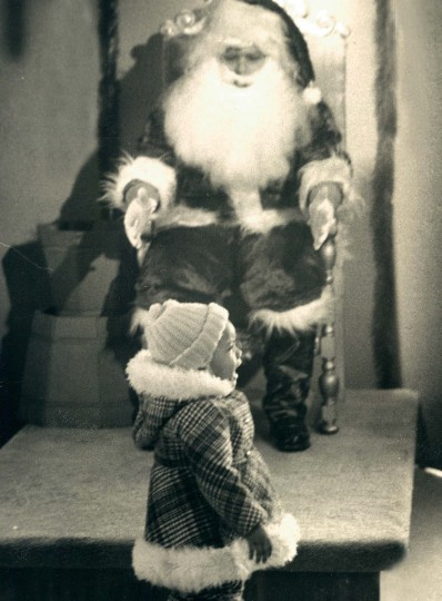 Santa Duane Raubaugh gets nothing but tears from two-year-old, Charmaine Simms in 1976.  (Lloyd Pearson/Baltimore Sun)