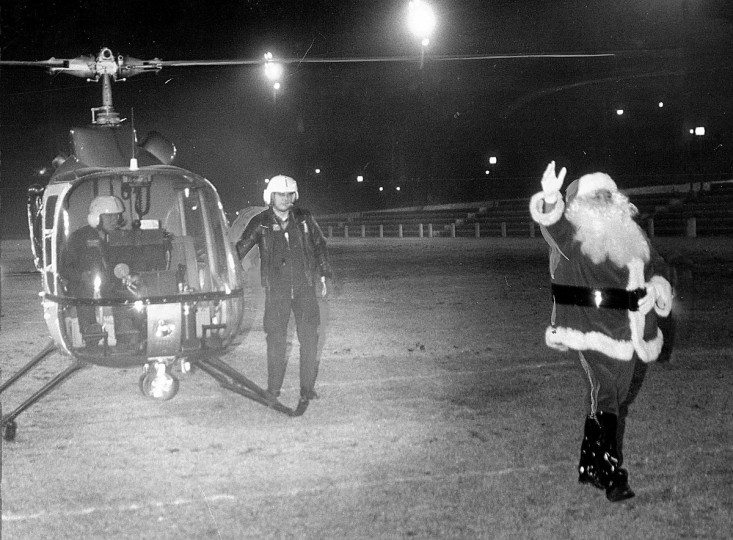 Santa Claus arrives by police helicopter to open Baltimore's Inner Harbor festivities in 1976. (Irving H. Phillips Jr./Baltimore Sun)