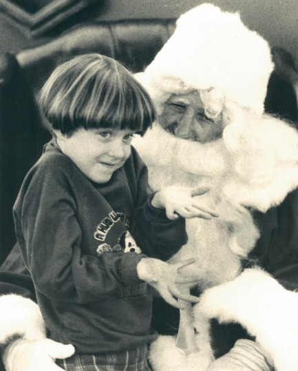 Julie Johnson, four-years-old, speaks with Santa Claus in 1980.  (Richard Childress/Baltimore Sun)